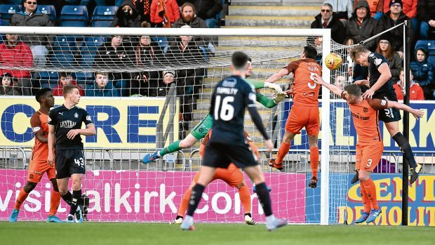 Falkirk's Peter Grant scores from a header to make it 1-1 during Dundee United's 6-1 capitulation at the weekend. The Tangerines will be hoping for a more prosperous new year than last season.