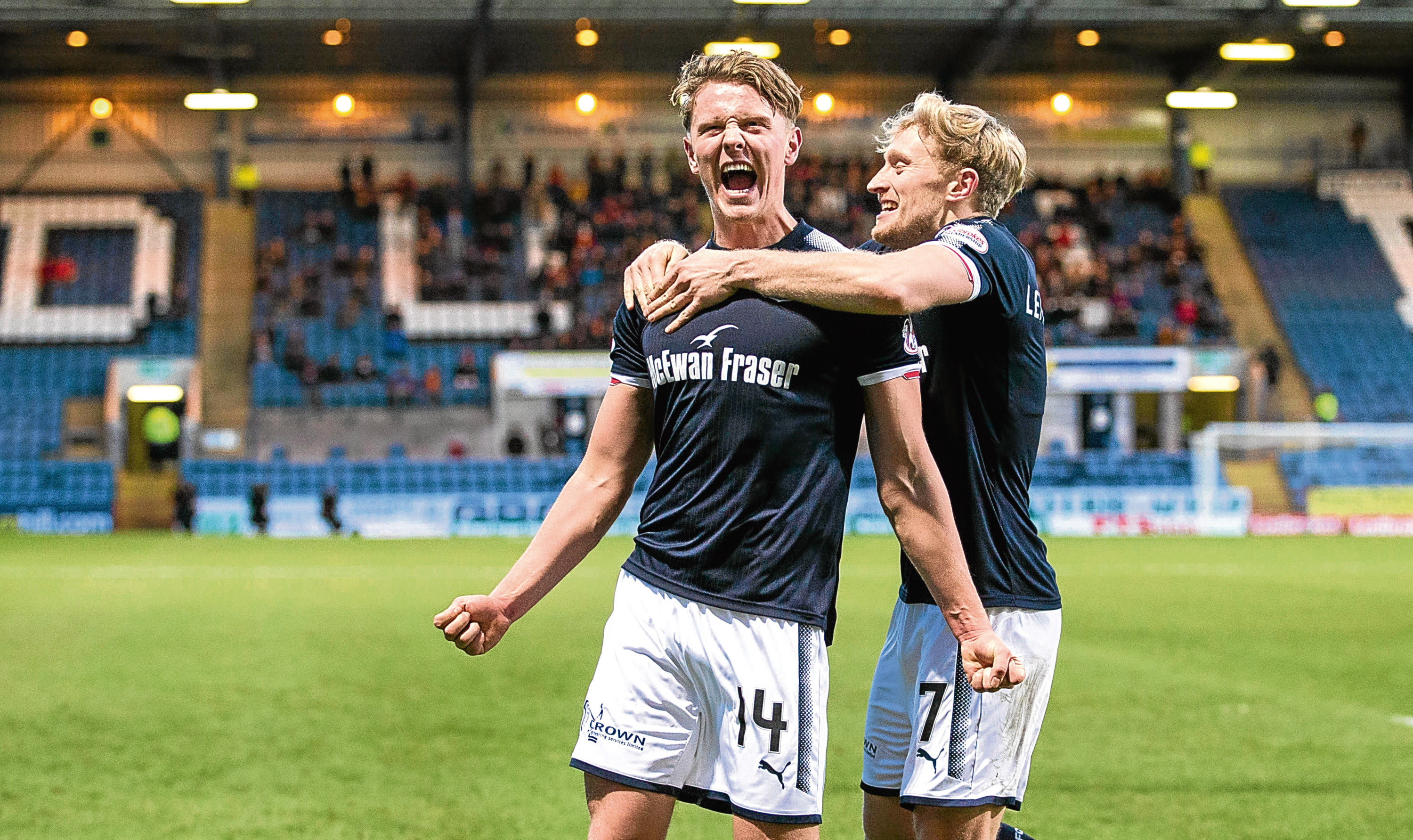 Mark O'Hara celebrates with A-Jay Leitch-Smith after scoring Dundee's second goal during their 3-0 win against Partick last month.