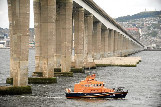 A lifeboat under the road bridge (stock image)