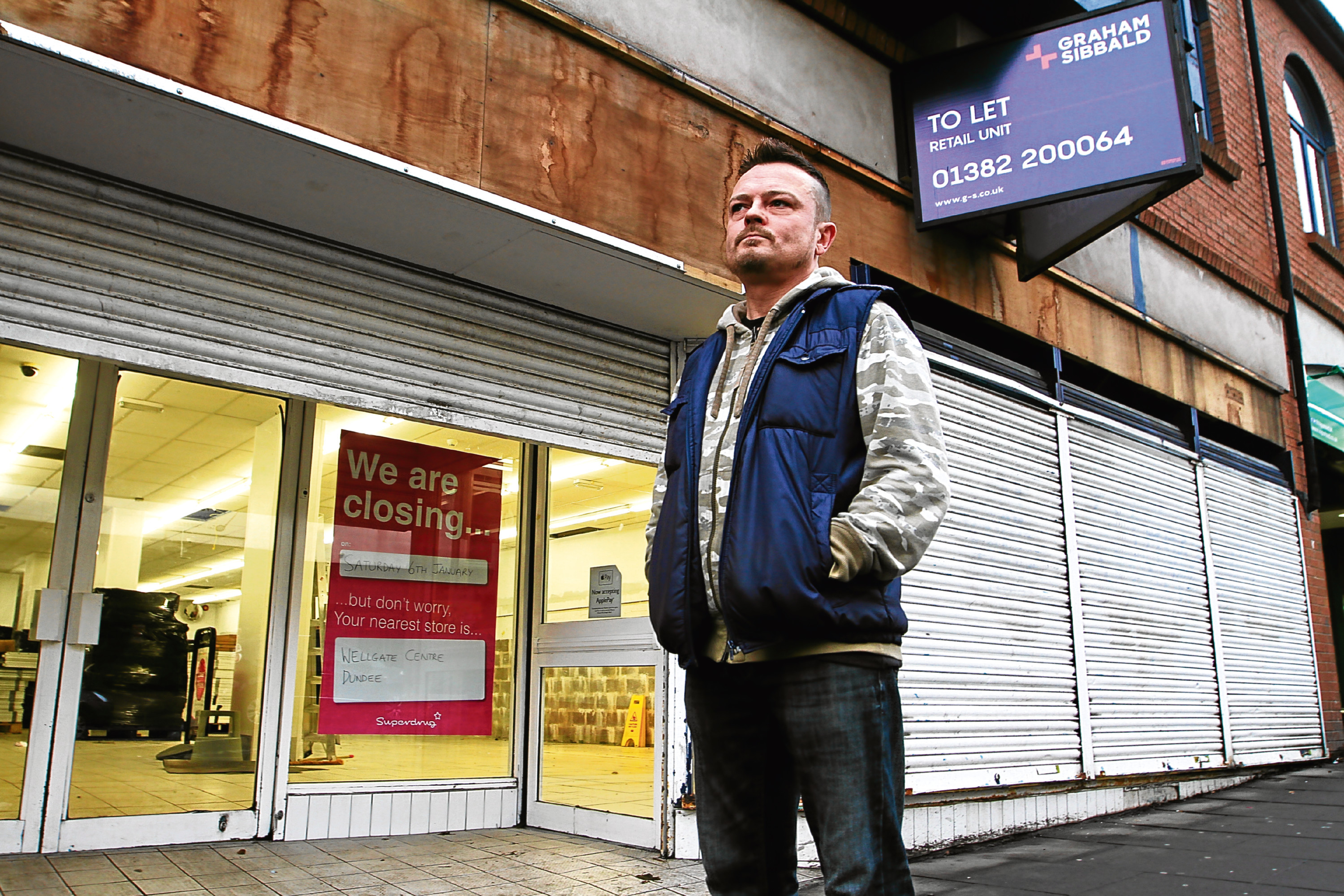 Myles McCallum outside the now empty Superdrug.