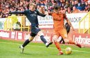 Scott Fraser (right)( in action for Dundee United.