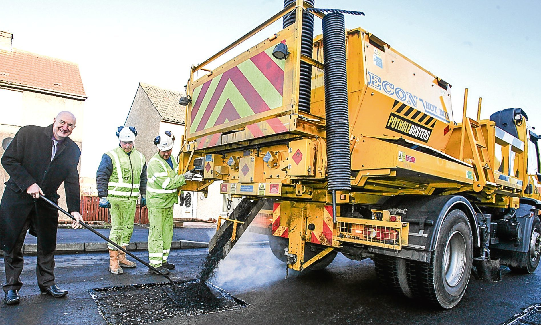 Cllr Neil Crooks is pictured in St Kilda Crescent, Kirkcaldy with the pothole buster team