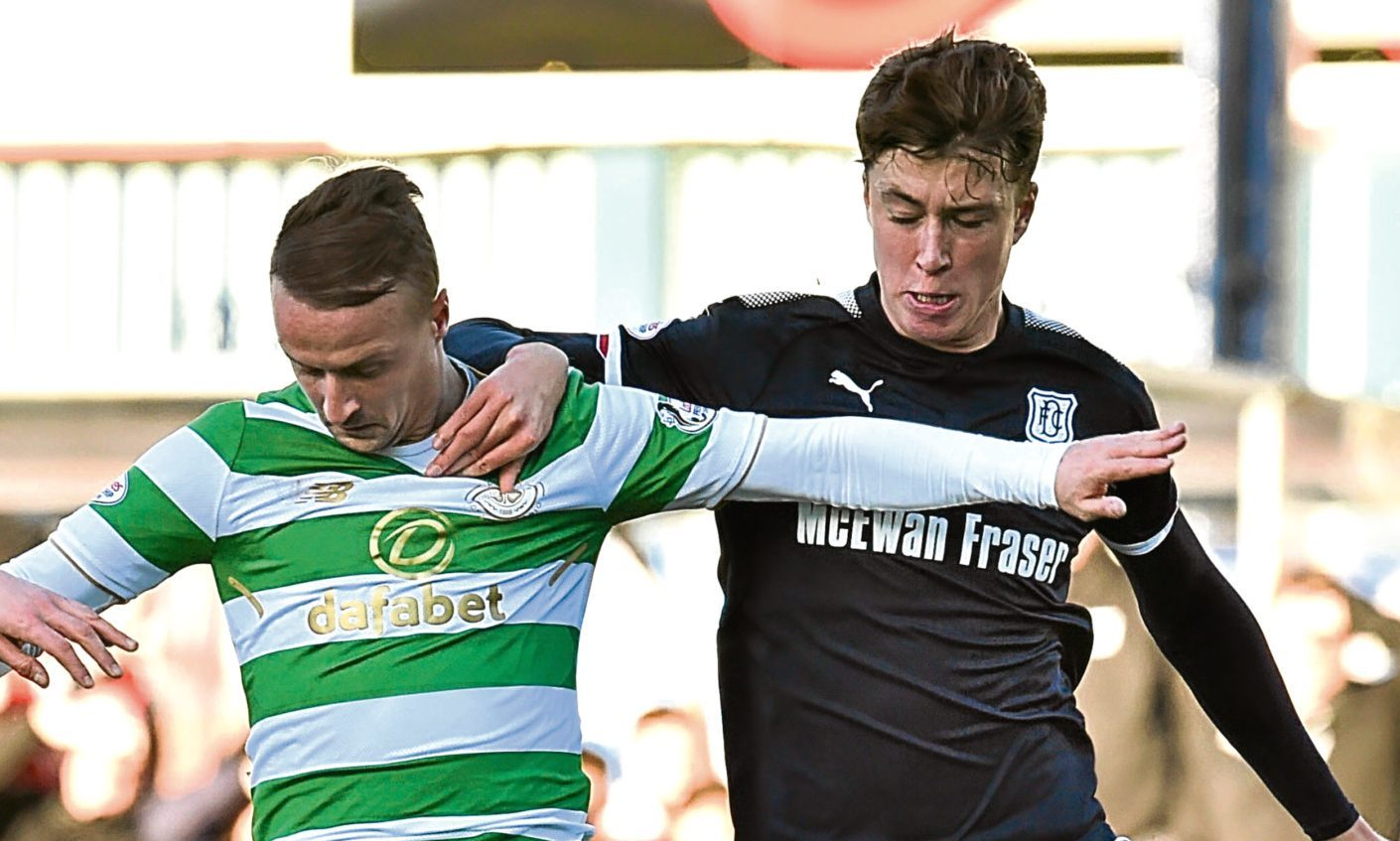 Jack Hendry (right) challenges Celtic's Leigh Griffiths during the visitors' 2-0 win at Dens Park on Boxing Day