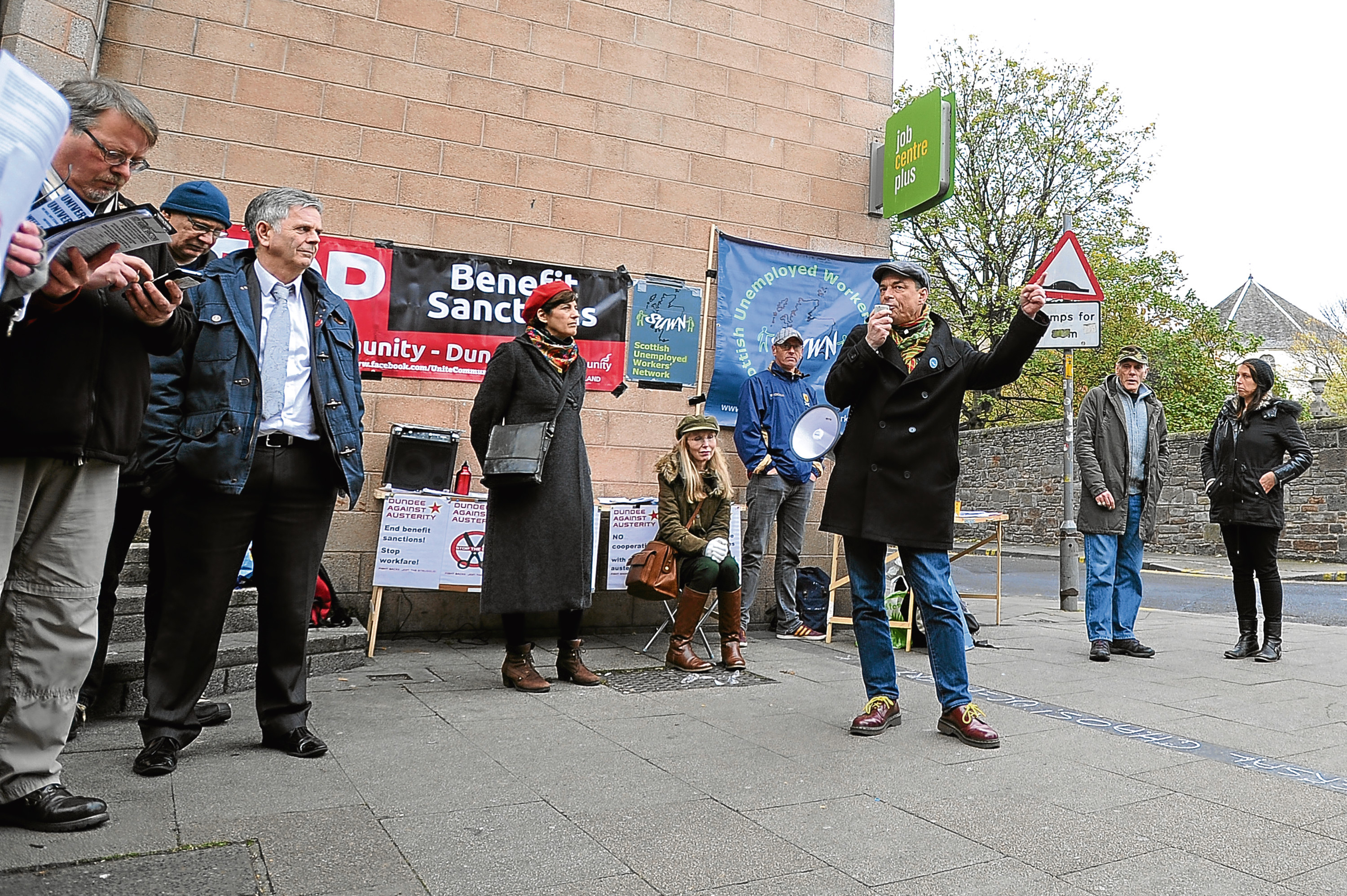 Members of Scottish Unemployed Workers' Network protest the 'roll-out' of Universal Credit outside Dundee JobCentre