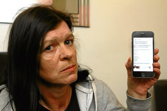 Sharon Reid shows text messages from one of her daughter's alleged bullies.