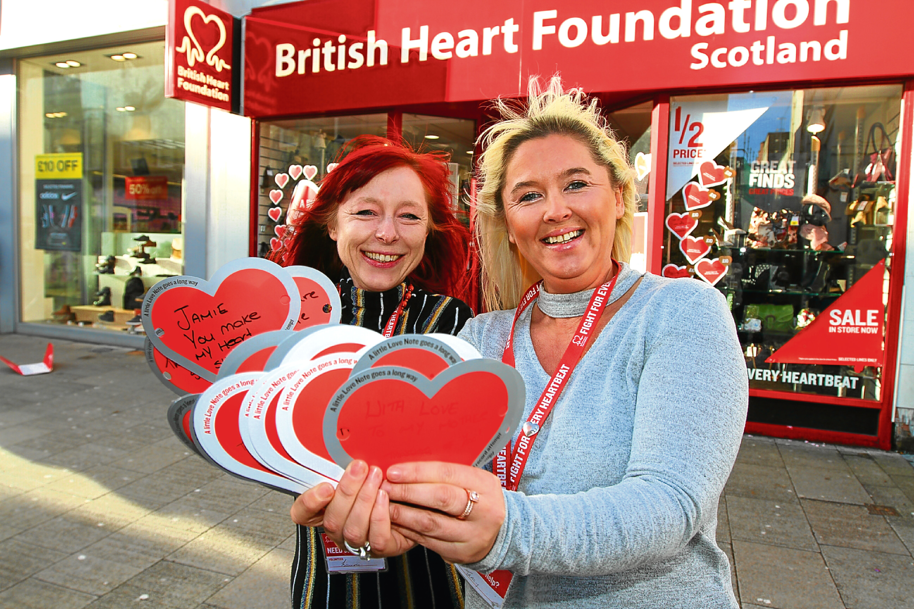 Laura McFarlane of BHF and manageress Tracy Perrie with some  hearts ready to go in the window.