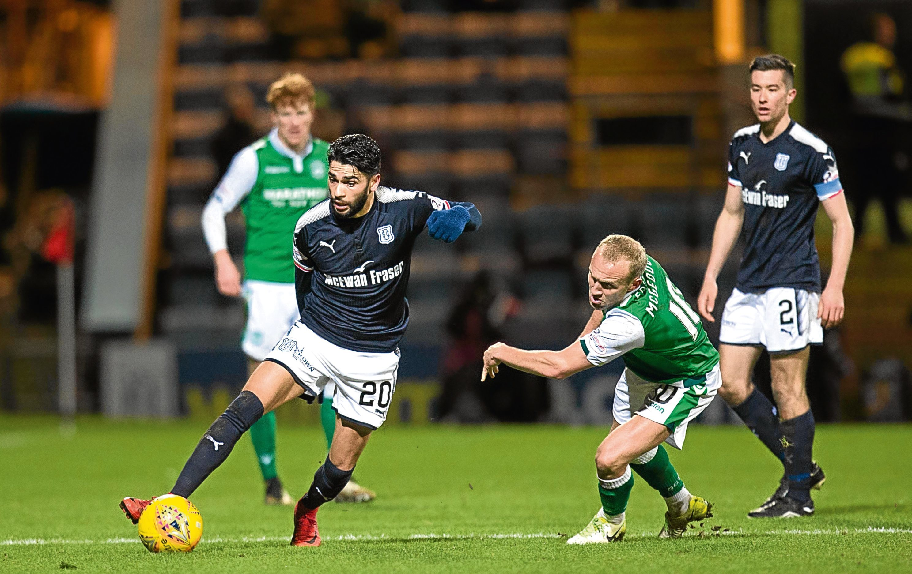 Dundee striker Faissal El Bakhtaoui goes past Hibs' midfielder Dylan McGeouch during the Dens Parker's 1-0 defeat on Wednesday evening.