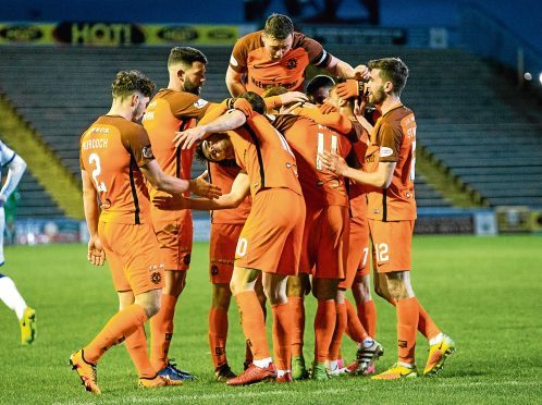 Billy King (No 11) is mobbed by team-mates after scoring his second goal to give the Tangerines a 2-0 win at Morton.