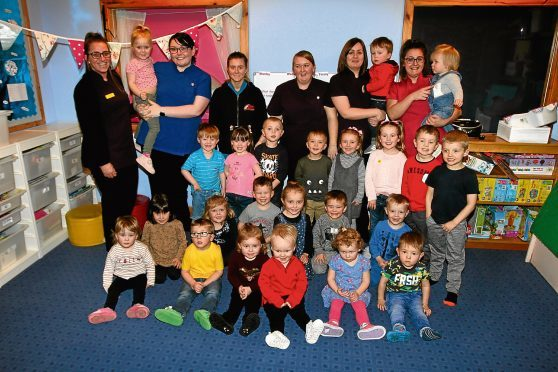 Staff and some of the kids at Rainbow Bright Childcare