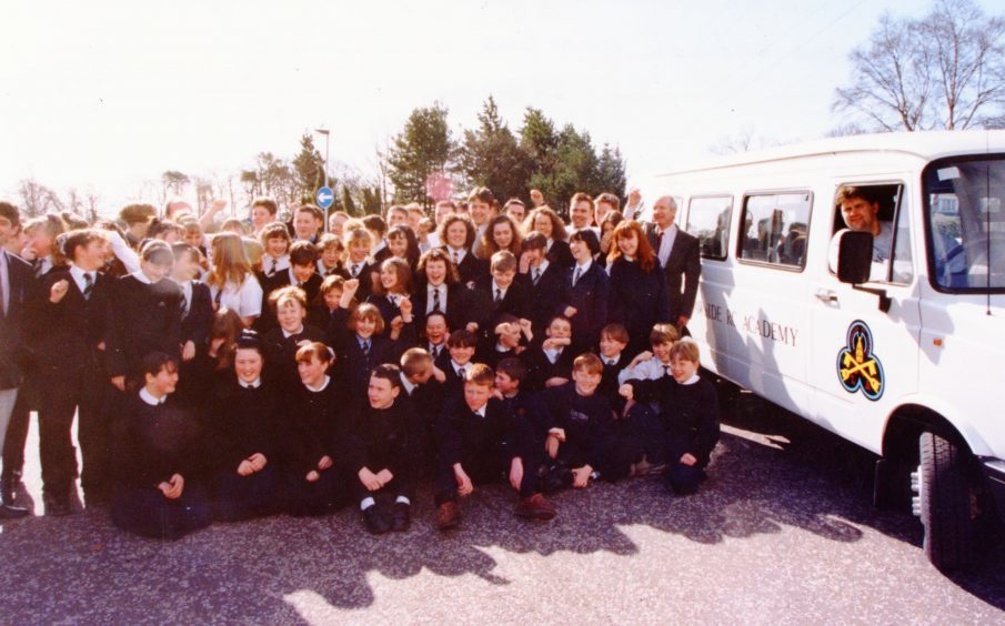 Lawside pupils pose beside the school's new minibus (March 1994)