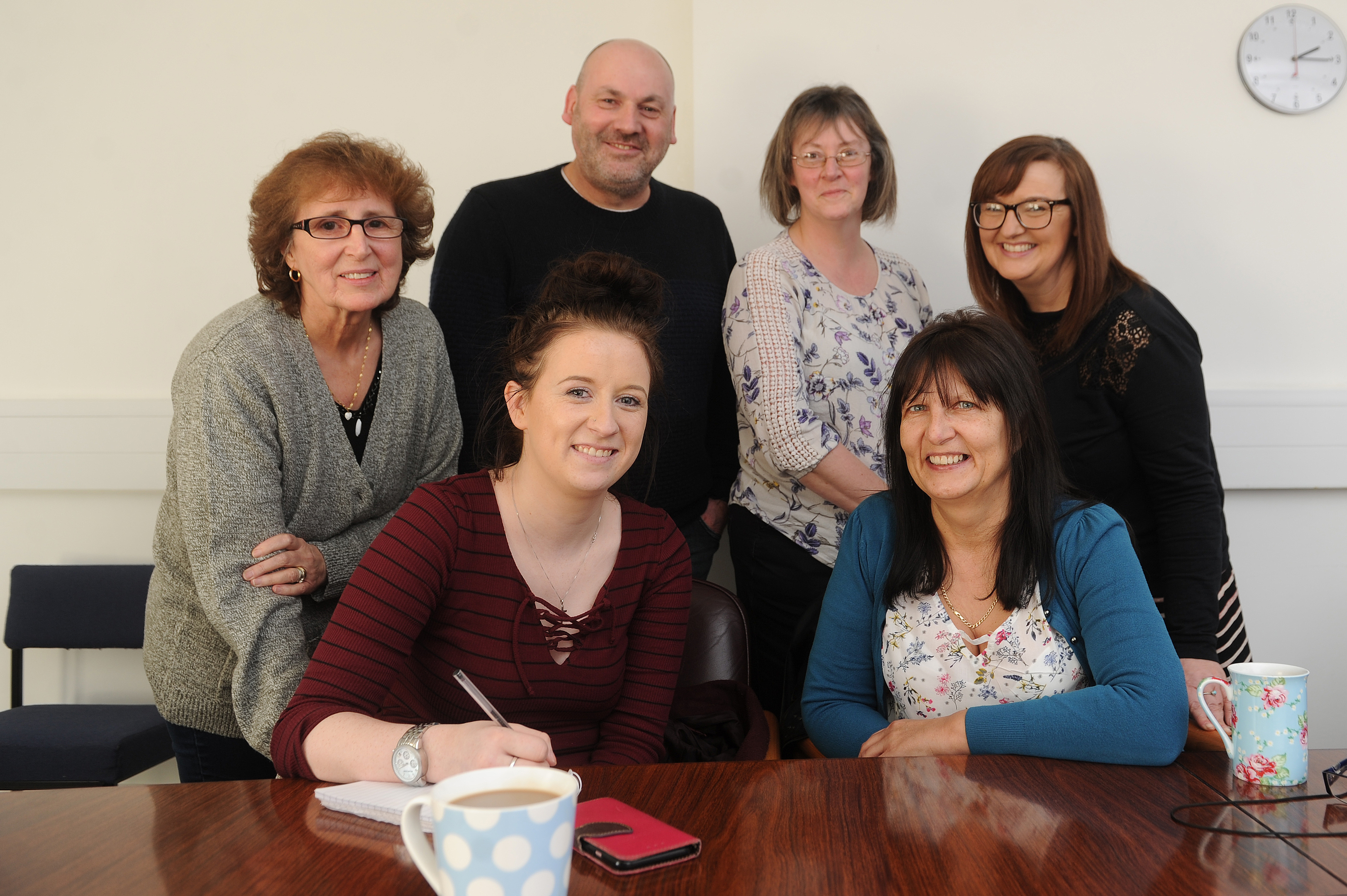Foster carers, back, from left: Liz Cussick, Richy Wynd, Fiona Brown and team manager Dawn Millar. At the front are Tele  reporter Amy Hall and foster carer Jean Buist.