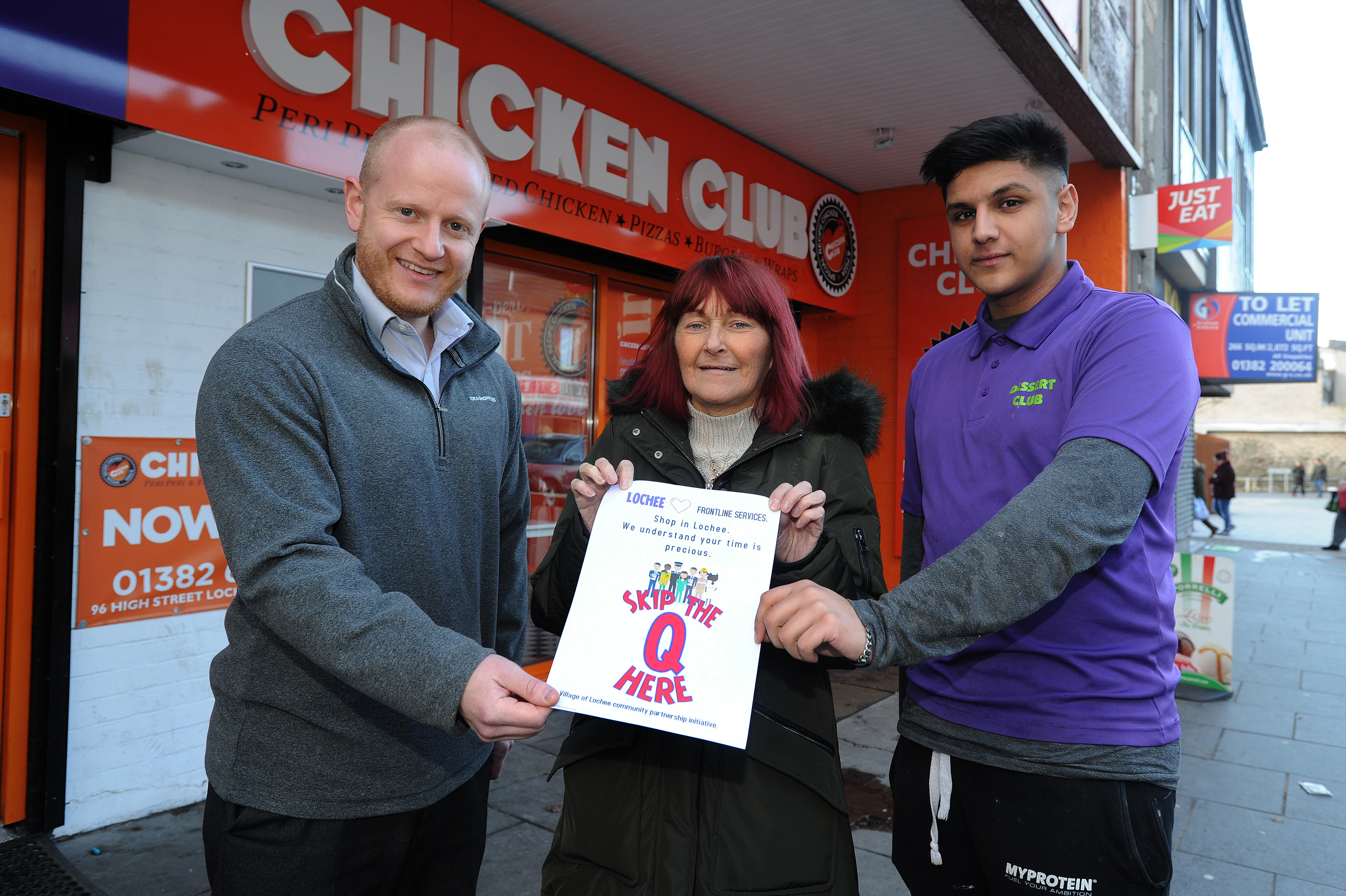 Council communities worker Lee Haxton, Janette Whitton of VOLCP and Usman Nasim of Chicken Club with the poster.