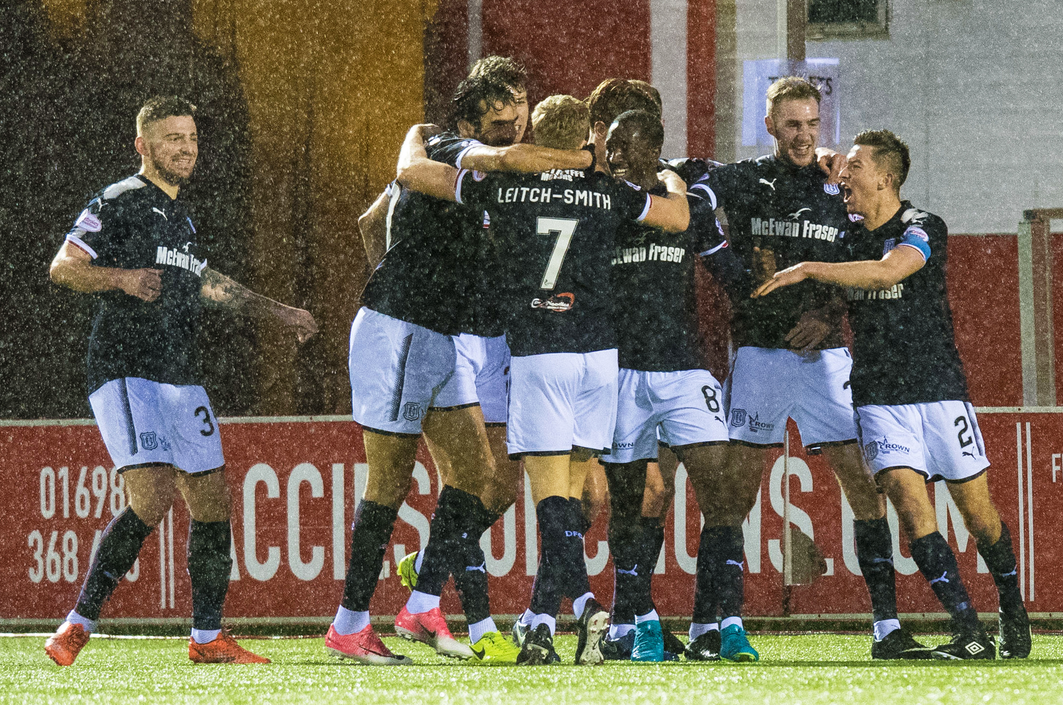 A-Jay Leitch-Smith (7) is mobbed by his Dundee teammates after his last-gasp winner.