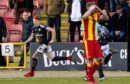 Simon Murray wheels away after clinching the winner for Dundee at Partick last weekend.