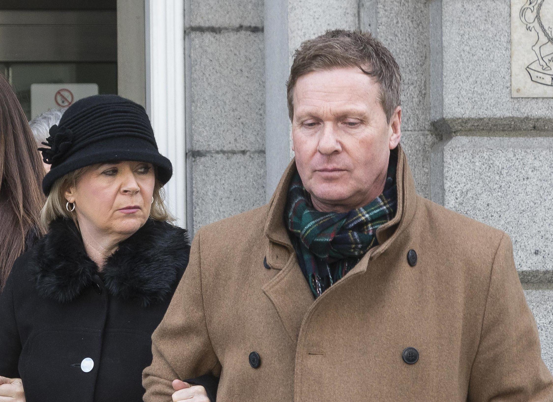 Linda McDonald  (centre) leaves court after Robbie McIntosh's sentencing with her husband Matt