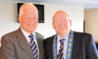 Ally Martin receiving his lifetime membership award from the Scottish Amateur Football Association president Charles R Gallagher
