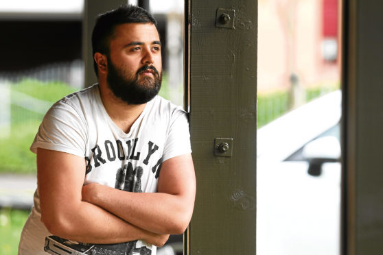 Eddie Ahmad's home was broken into while he was on holiday