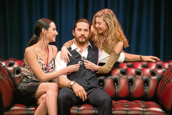 Emily Denton (left) and Eli Anguolova with the new Madame Tussauds waxwork figure of actor Tom Hardy, which features a soft, warm torso and a beating heart