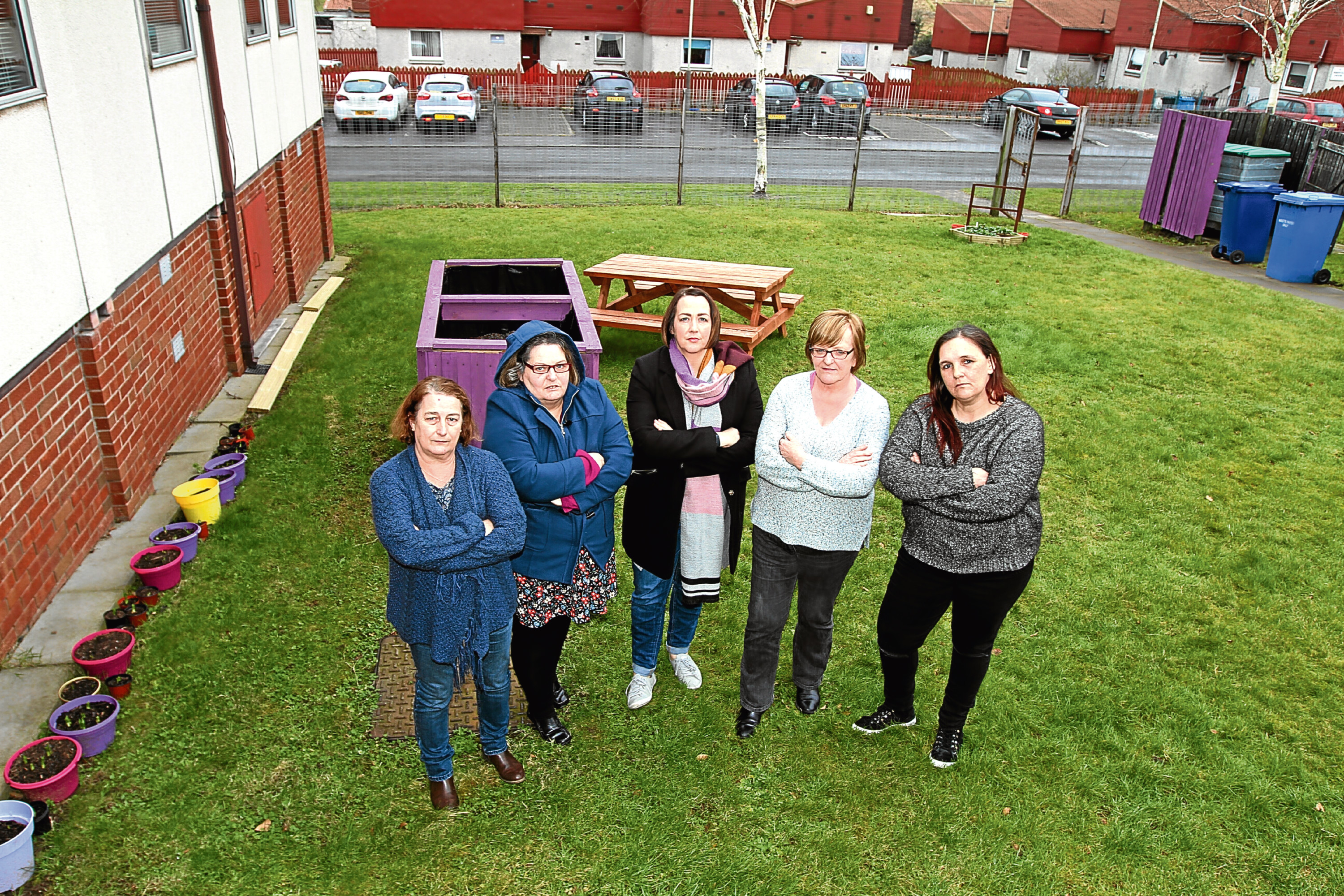 Staff members Sandra Stewart, Philippa Lyttle, Emma Beatt, Anita Jamieson and Tammie Brown at the area in the garden where the bench used to be