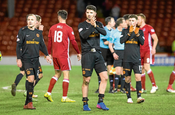 Mark Durnan (left) and Jamie Robson applaud the 941 travelling Tangerines fans at full time after exiting the Scottish Cup at the hands of New Firm rivals Aberdeen at Pittodrie on Sunday.