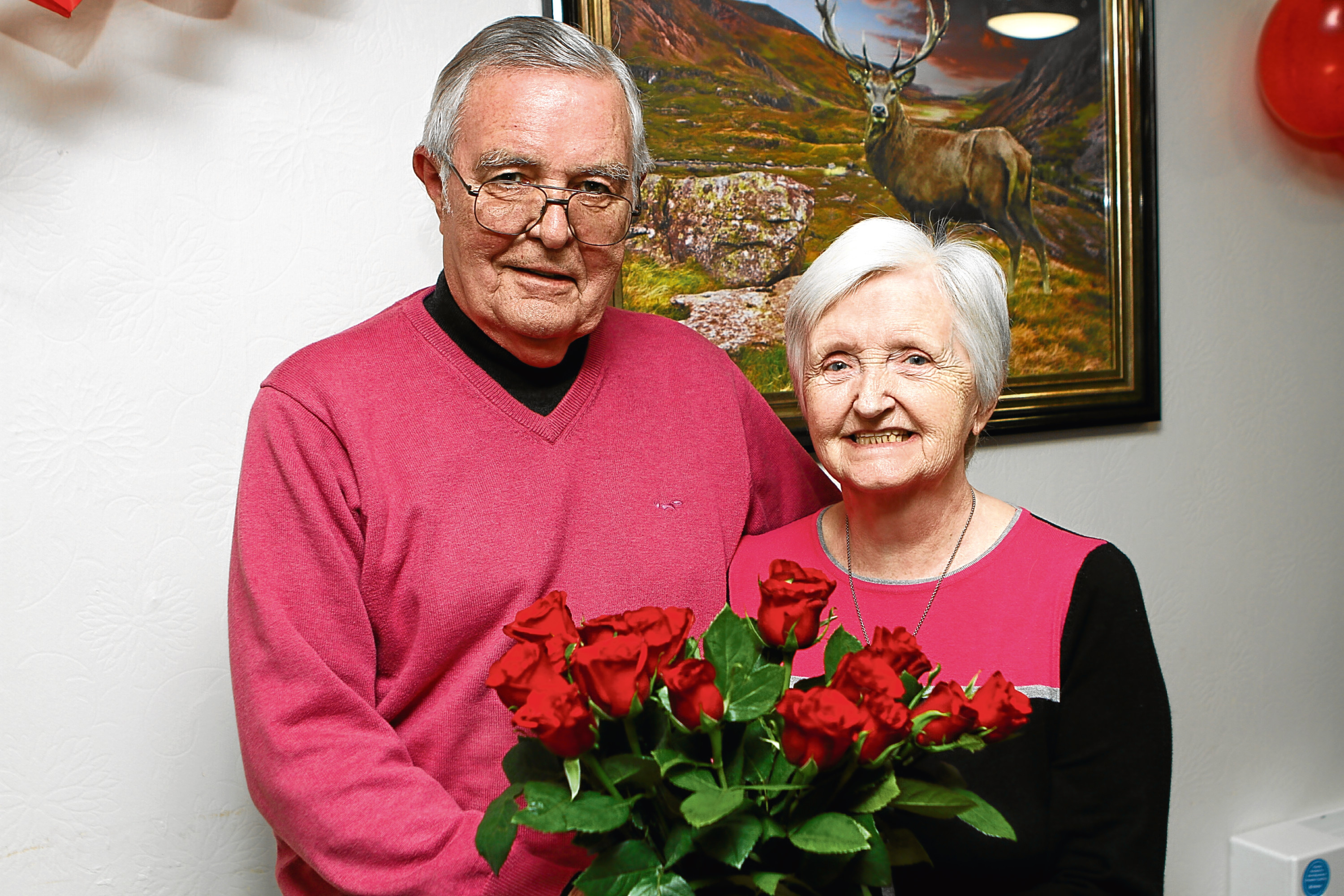 Residents Paddy and Betty Johnson, who have been married for 56 years, celebrate Valentine's Day with some roses