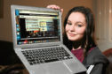Baldragon Academy pupil Emily Wilson, 17, at home watching the video she made about the school's move to a new building