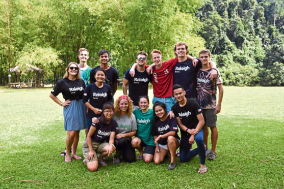Lauren with fellow Raleigh International volunteers working on projects in Borneo