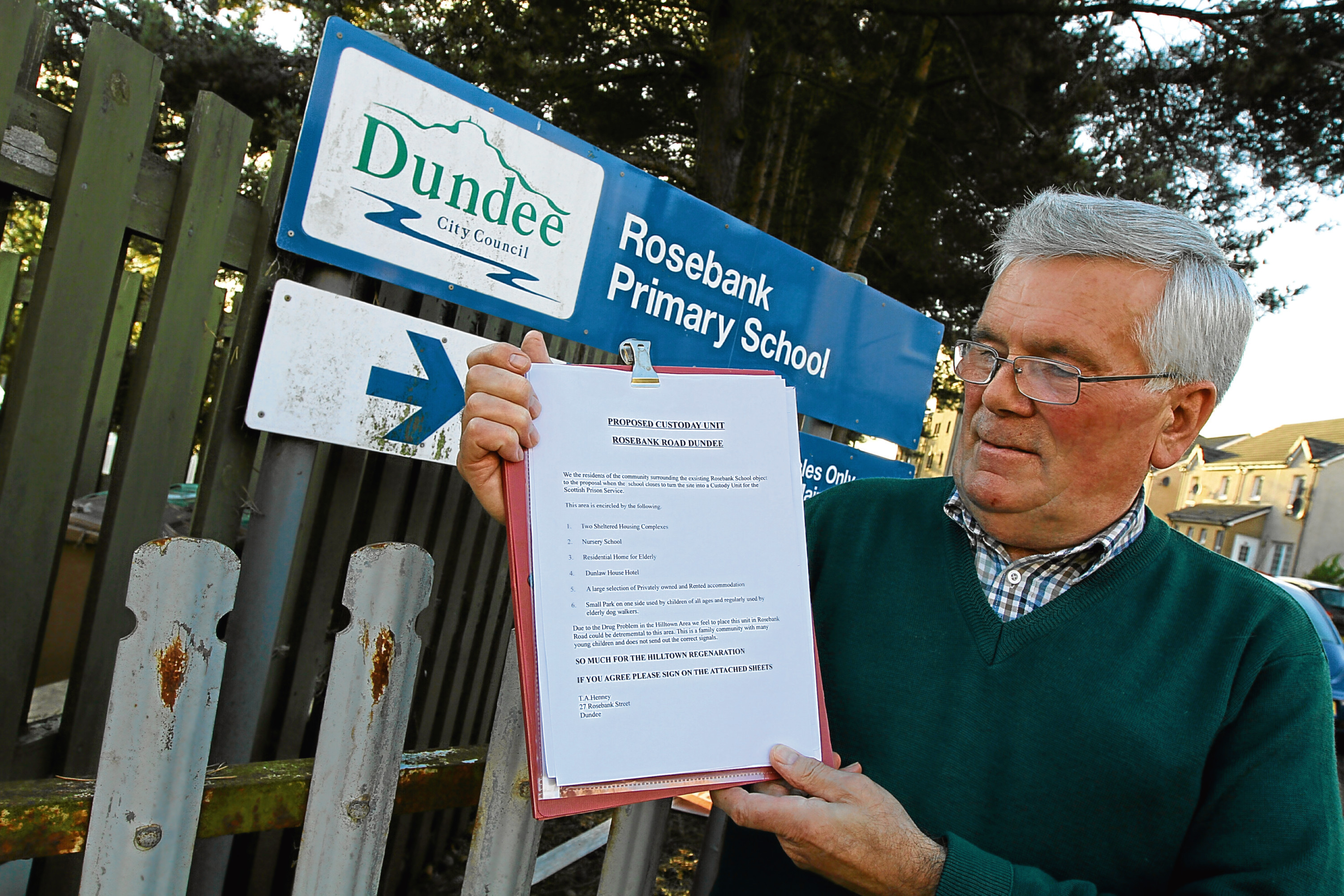Tom Heeney with his petition against the proposed custody unit