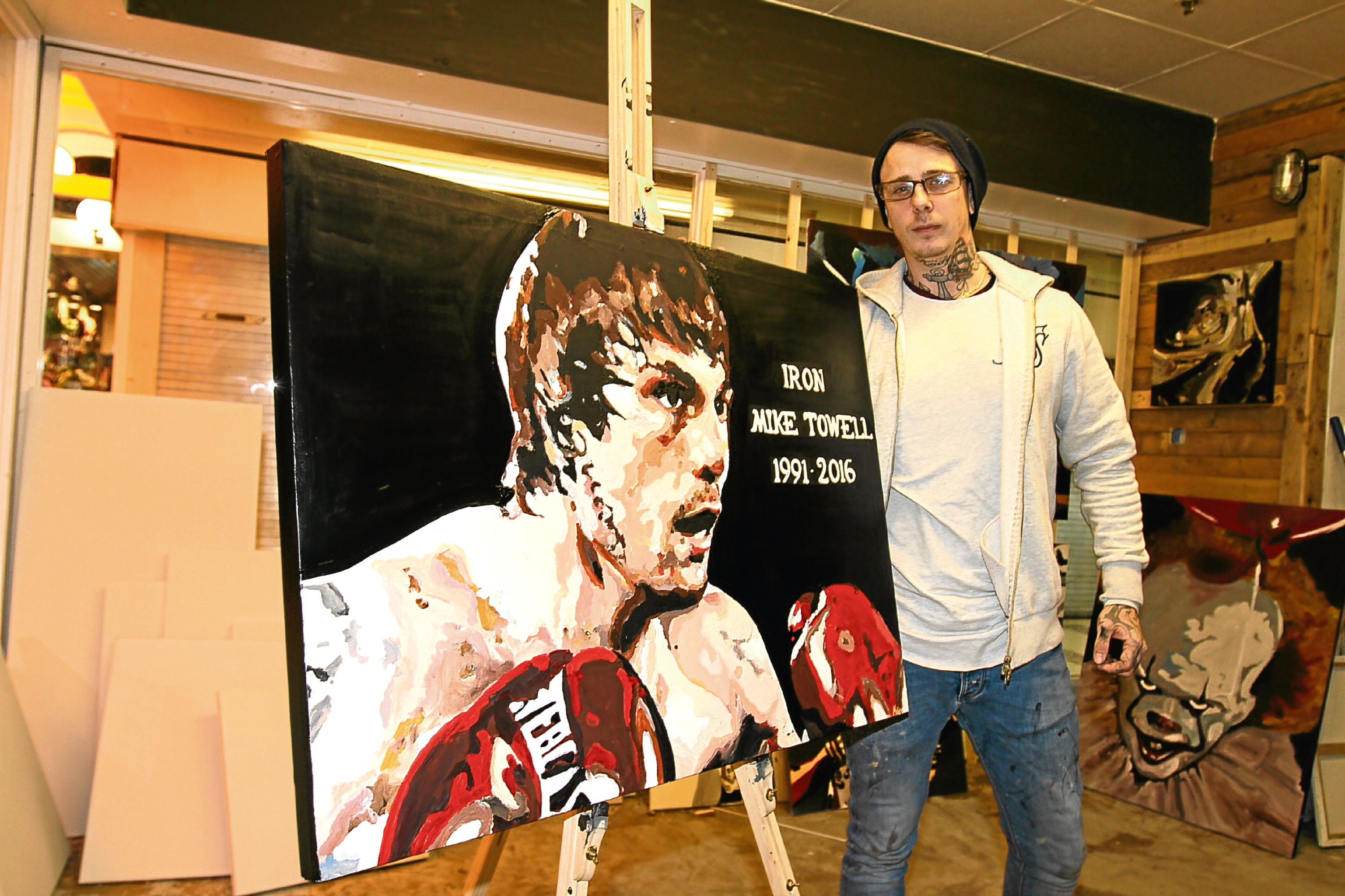 John with his painting of Mike Towell