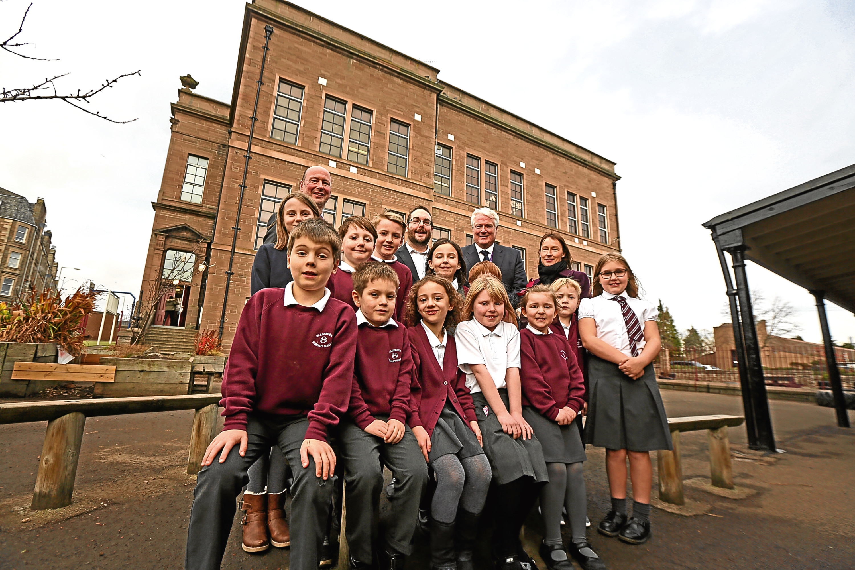 Gregor Murray, middle back row, and Paul Clancy, back row second right, with Blackness Primary School staff and students.