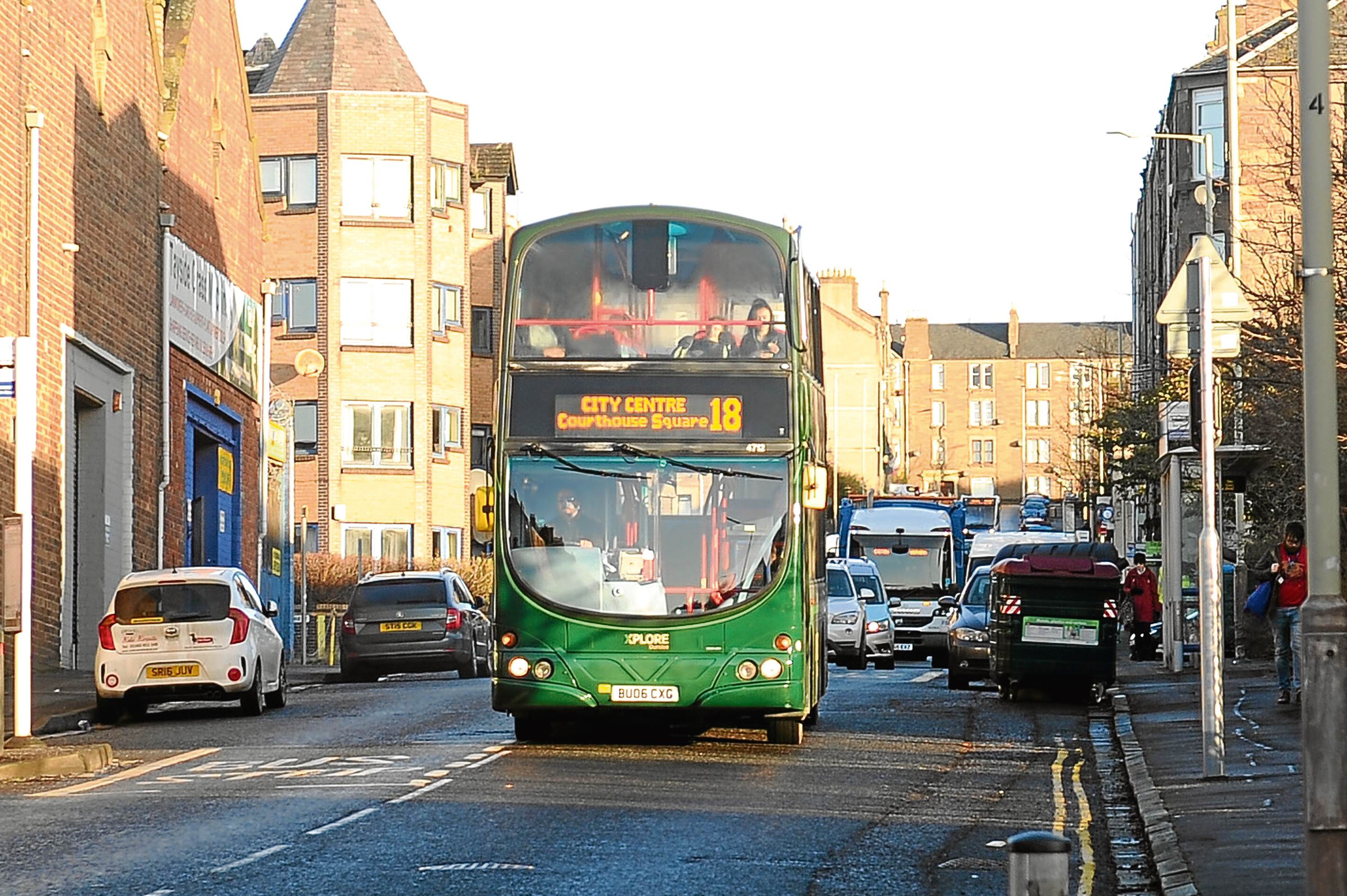 An Xplore No 18 bus on its route at Arklay Street near Dens Road.