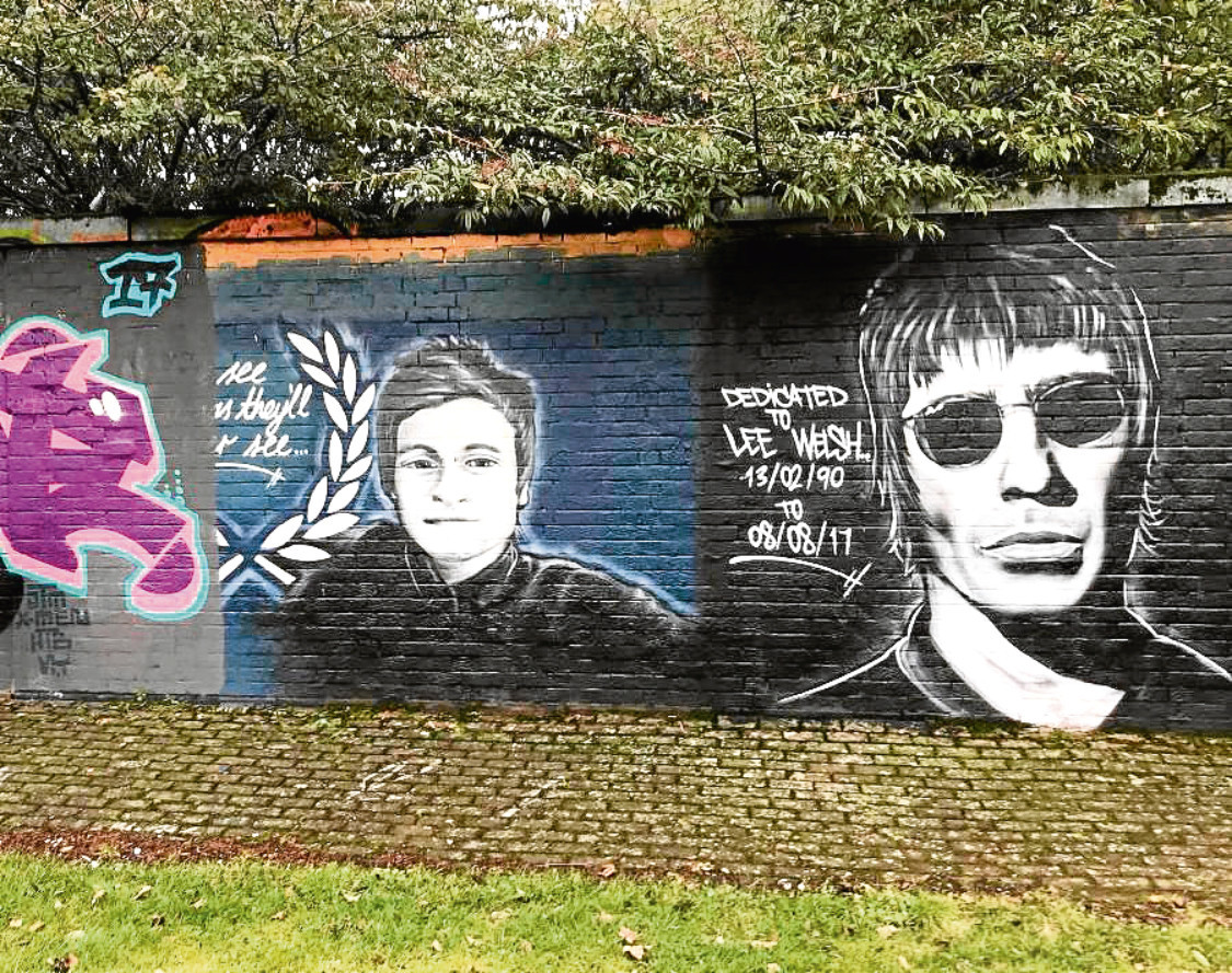 The Oasis-themed memorial mural to Lee Welsh has been partially painted over by a graffiti artist.