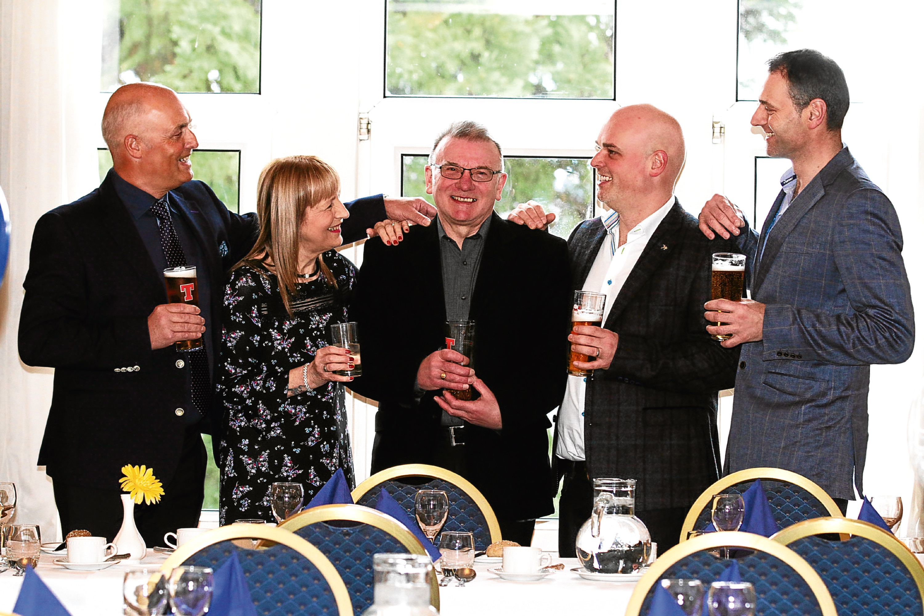 Doug, centre, pictured with his wife Jeanette and, from left, Jackson Steel Structures' managing director Stewart McArthur, engineer Stephen McArthur and director Mike Darcy.