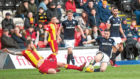 """Dundee's Cammy Kerr goes in hard with Partick's Martin Woods in the Dark Blues' 2-1 success at Firhill last weekend. A win that showed the """"never-say-die"""" spirit of the players, according to Kerr."""