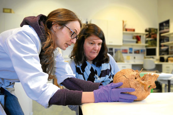 Laura Girdwood and Christina Donald with the skull.