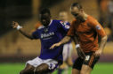 Genseric Kusunga (left) in action during his Olgham day's against former Dundee favourite Leigh Griffiths, then of Wolves.