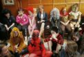 First Minister of Scotland Nicola Sturgeon alongside kids dressed up as characters on a previous World Book Day
