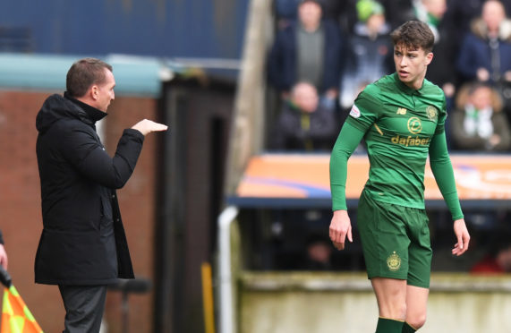 Jack Hendry gets instructions from Brendan Rodgers on his Celtic debut