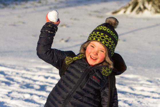 John Mackie (aged 6, from Inchview Primary School) having fun in the snow on walk to school in South Inch, Perth