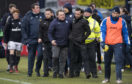 Neil McCann is led away after the altercation after the 4-0 thumping from St Johnstone