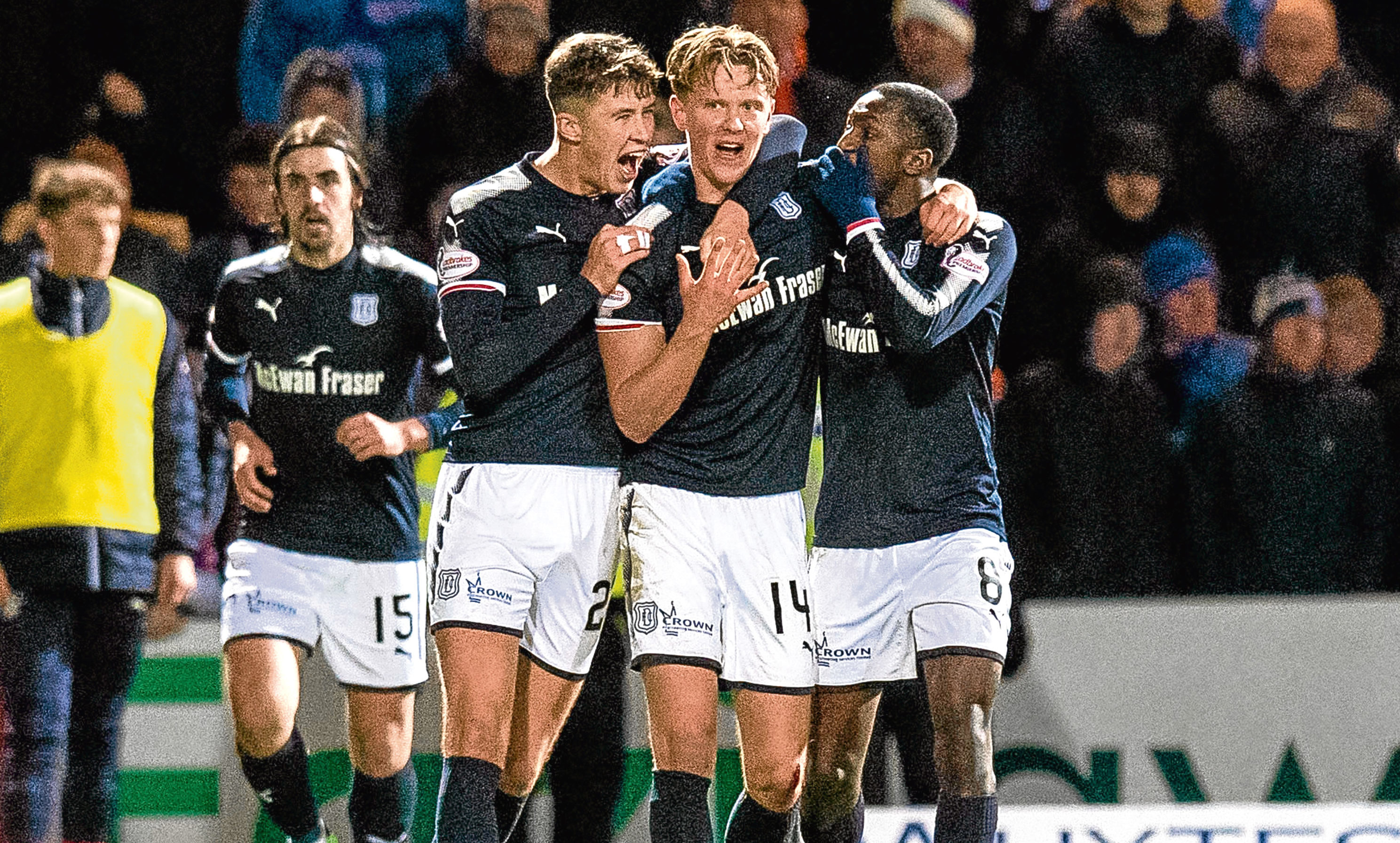 Dundee's Mark O'Hara (second from right) celebrates his winning goal against Rangers in November