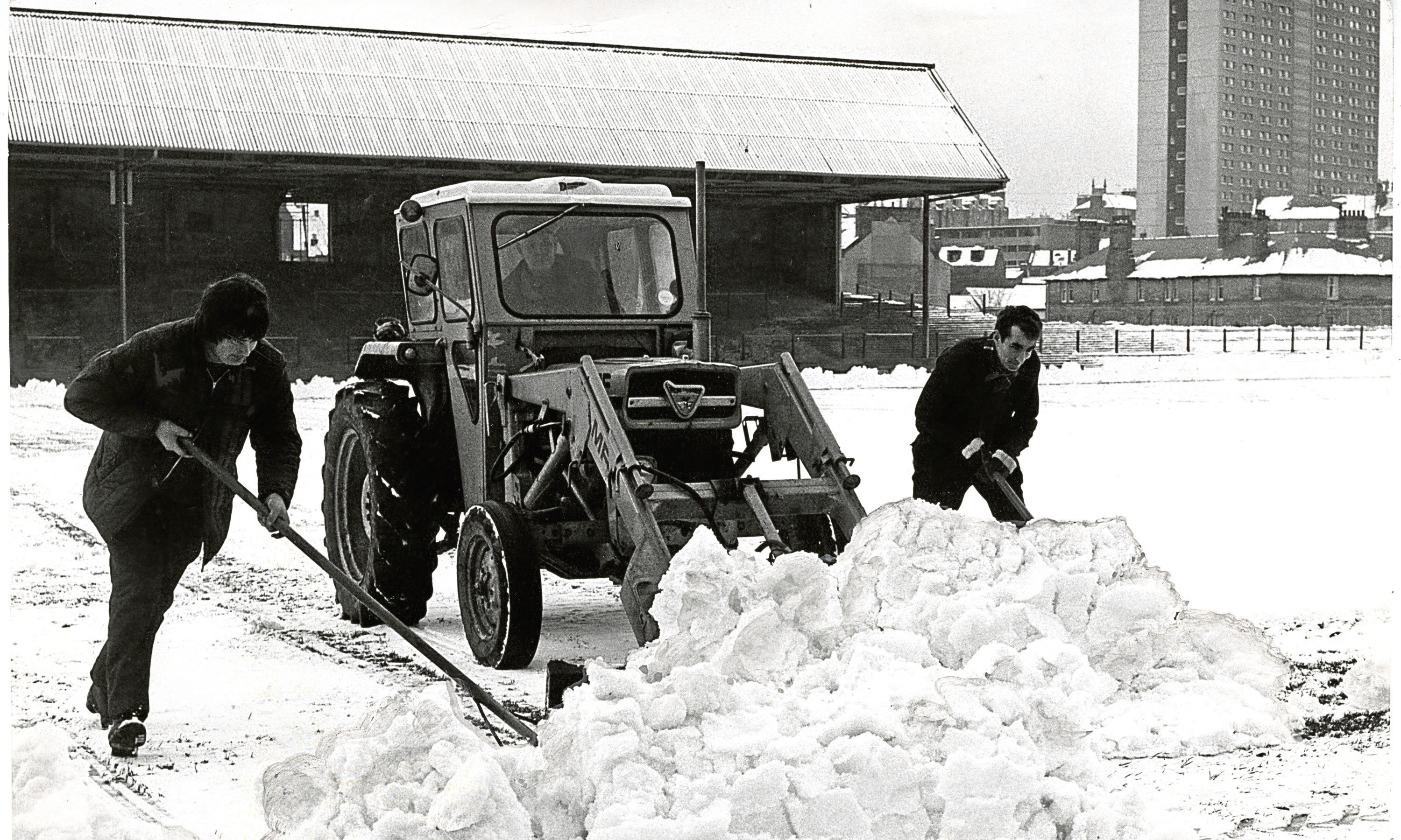 Workmen clear heavy snow at Dens Park for the game against Celtic on December 13 1974