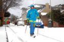 Angus Sangster uses telemark skis to get around the streets of Carnoustie during the snow storms