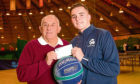 Picture shows David Taylor presenting Ben with a £200 cheque on behalf of the Sports Council.