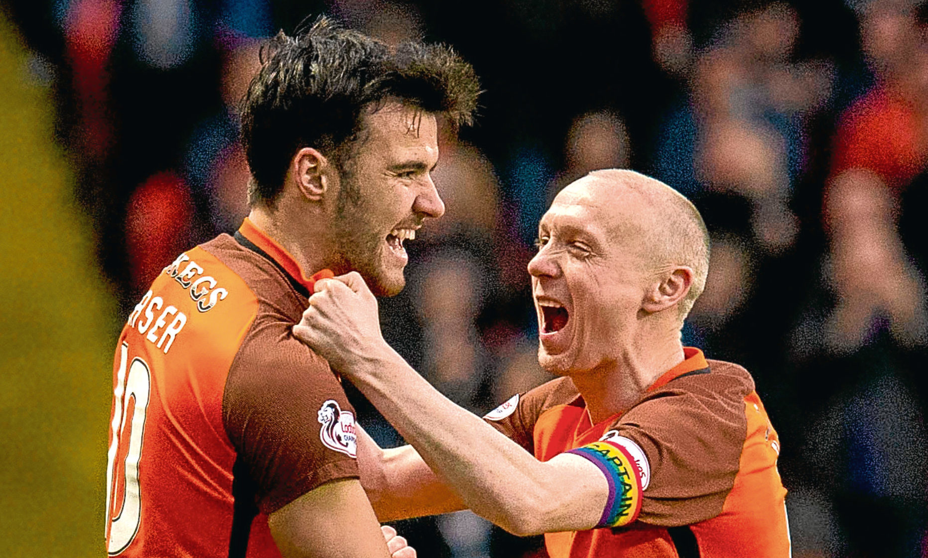 Dundee United's Scott Fraser (L) celebrates his goal against Dunfermline in December with Willo Flood