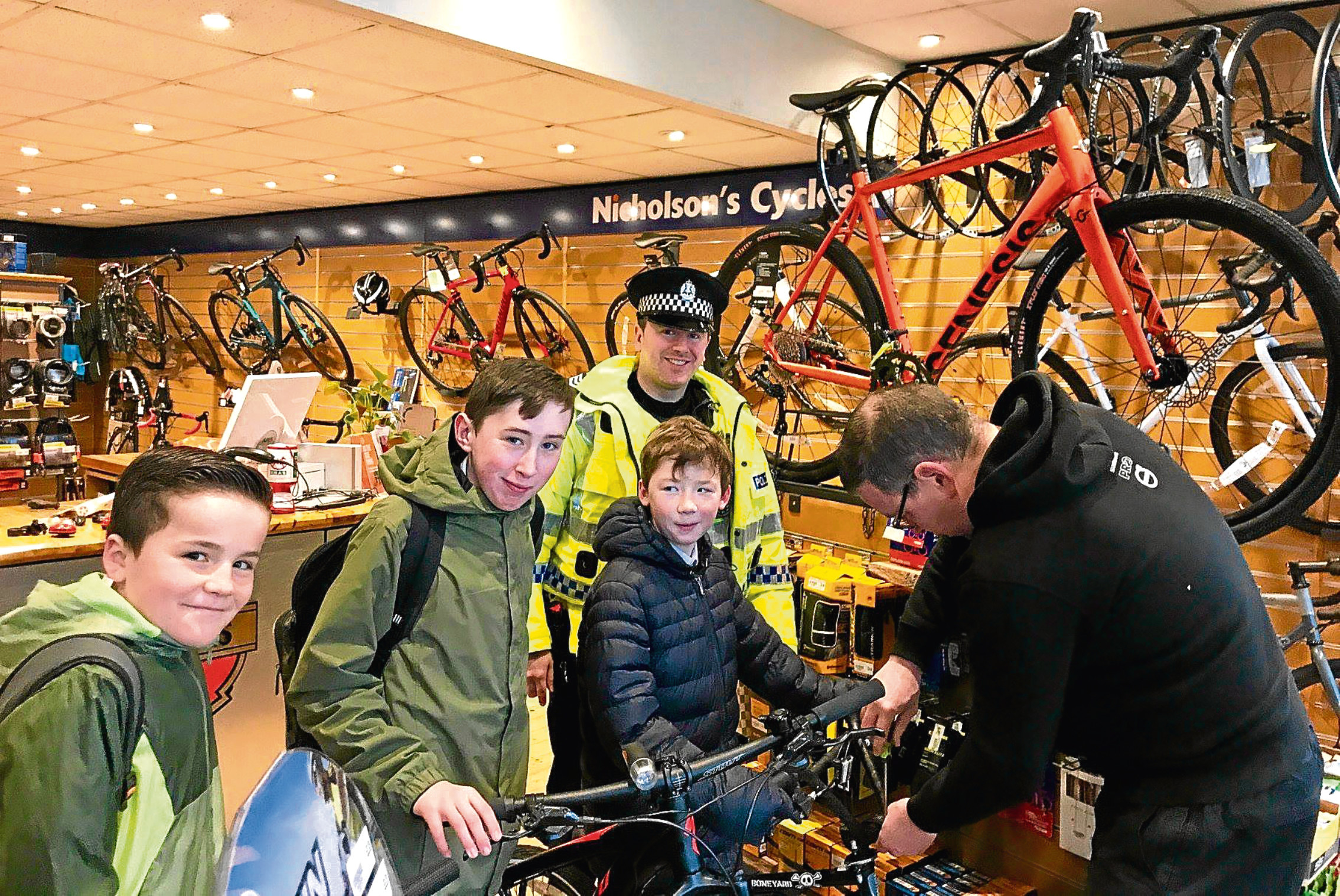 Lennon Henderson, Jack Frame and Steven Wilson received their new lights at Nicholson's store, and Maryfield Community Sergeant Alex Munro, along with DISC Target Project's Allan Howieson, were there to make sure eveything went smoothly