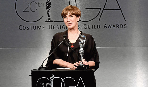 Jane Petrie collects her award at the Costume Designers Guild Awards in Los Angeles.
