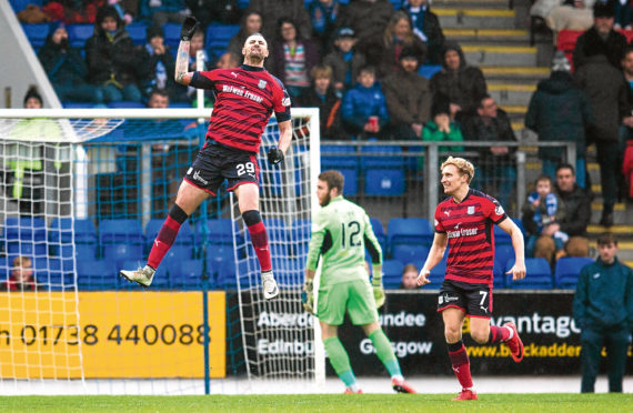 Striker Marcus Haber leaps for joy after putting Dundee ahead against St Johnstone at McDiarmid Park.