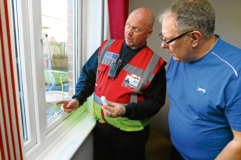 Community Safety Warden Billy McGregor with Ardler resident Kenny Goff