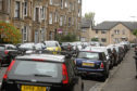 Cars parked in Bellfield Avenue, West End